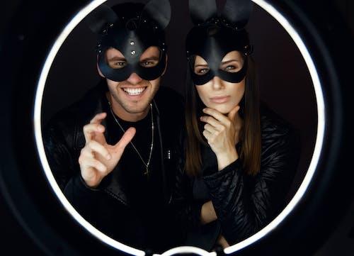 Woman in Black Leather Jacket Beside Woman in Black Leather Jacket