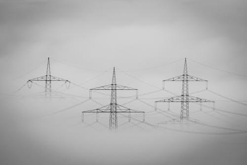 Black Electric Post Under White Sky