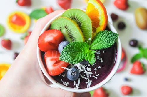 Sliced Fruit in Red Ceramic Bowl