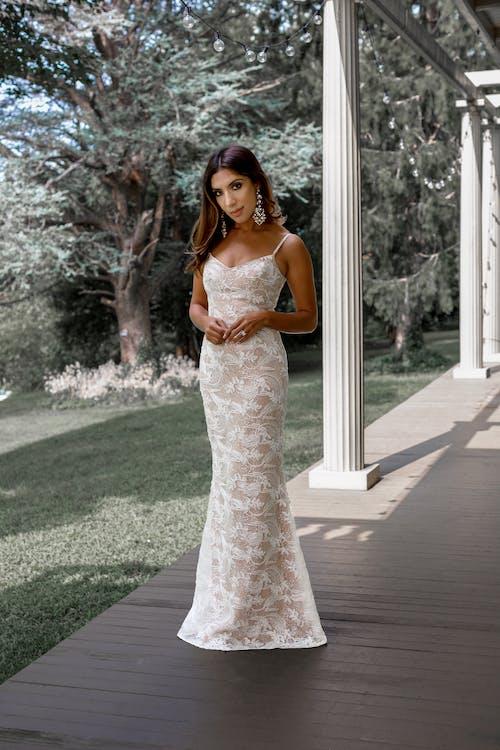 Elegant woman in white dress on terrace