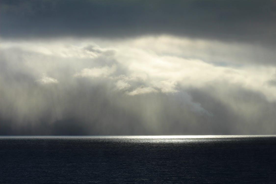 Sea Under White Clouds