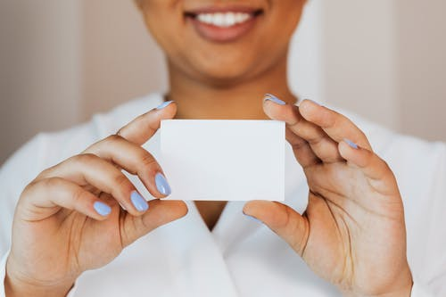 Person Holding a Small White Paper