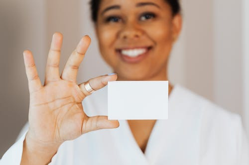 Woman Holding a Small White Paper