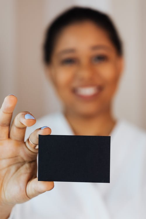 Woman Holding a Small Black Paper