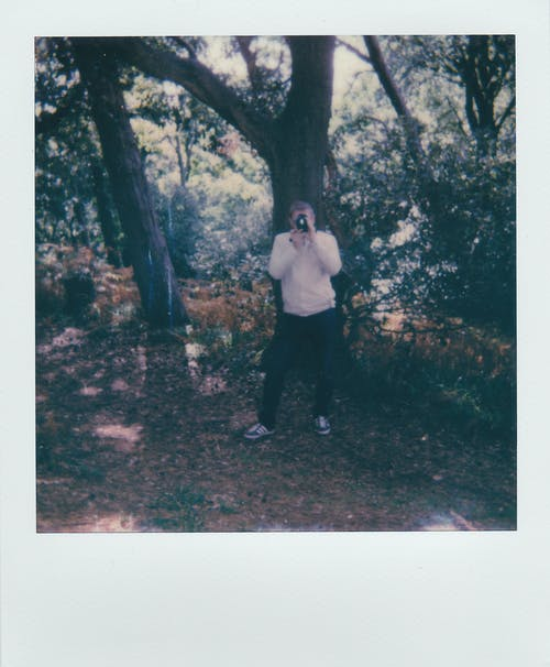 Man in White Dress Shirt and Black Pants Standing on Forest