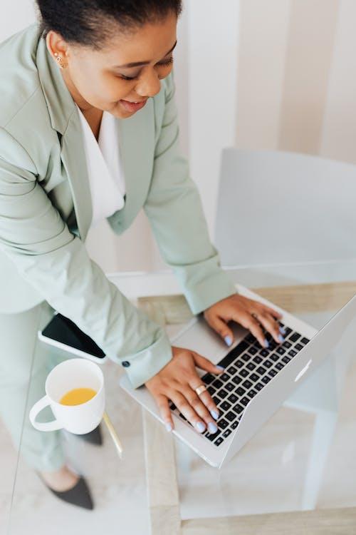 Man in White Suit Jacket Using Macbook Pro