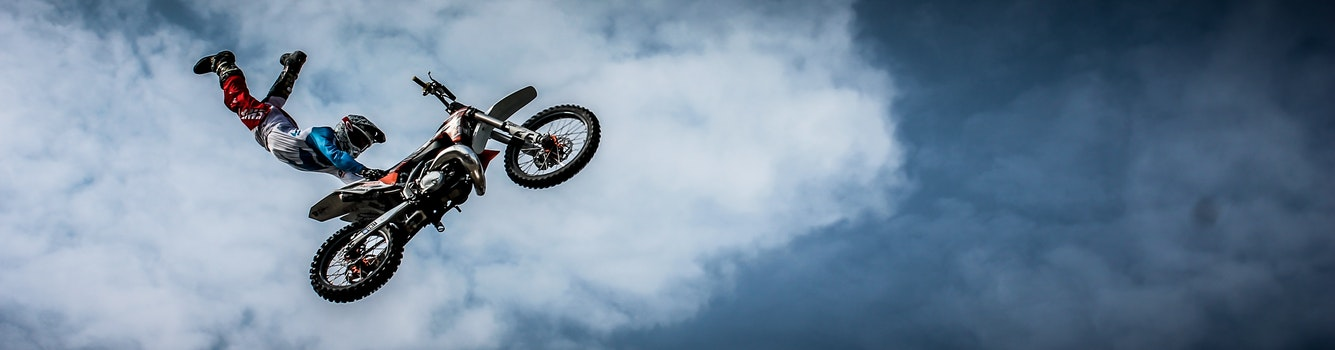 Man With Off Road Motorcycle Doing Tricks