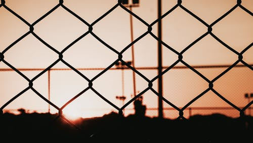 Silhouette Photo of Chain-Link Fence
