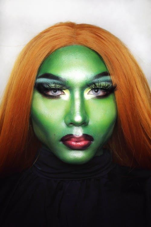 Woman with green paint on face