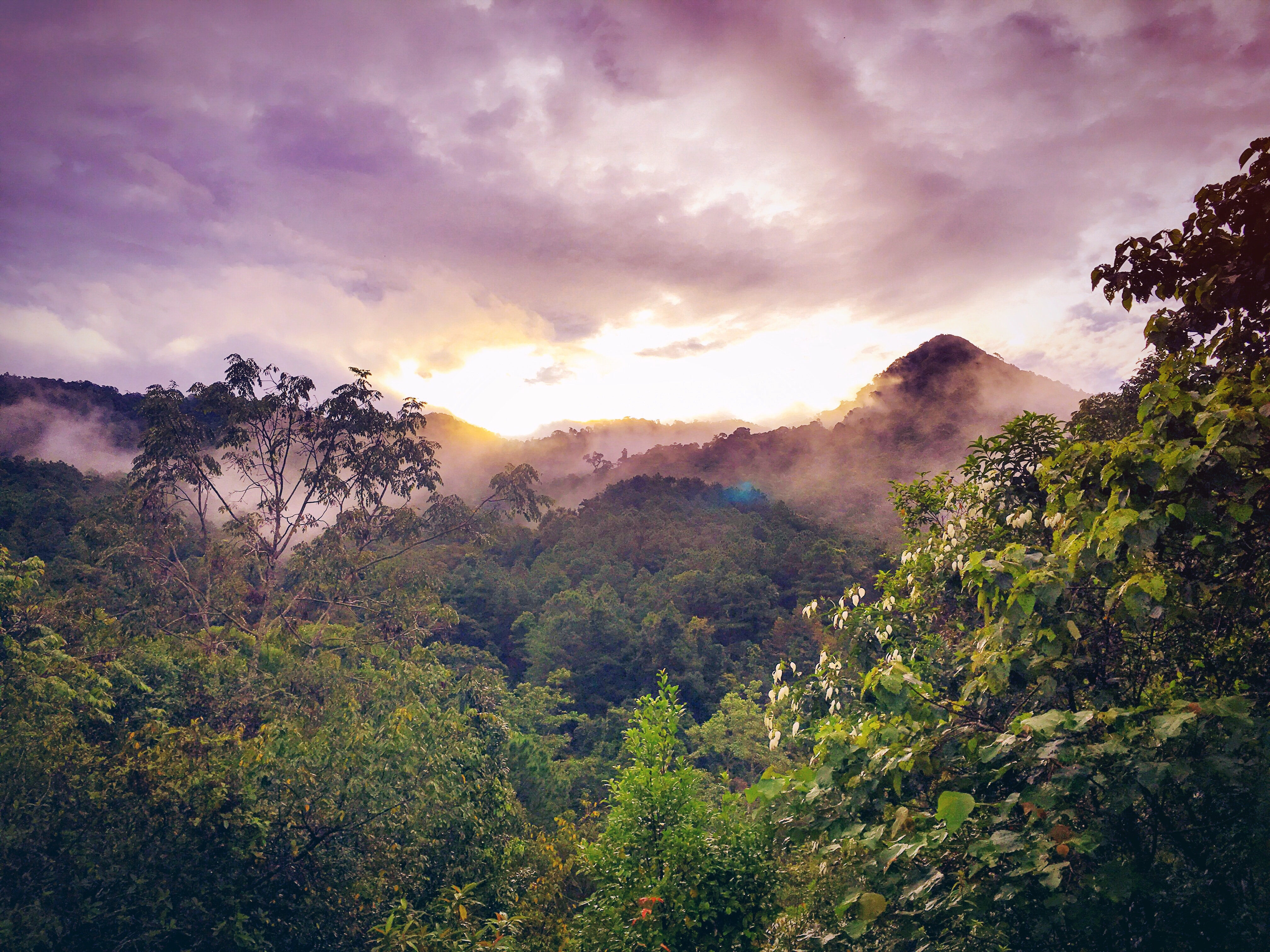 brown mountain under cloudy sky during sunset  u00b7 free stock photo