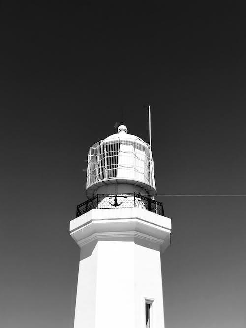 White and Black Concrete Lighthouse Under White Sky