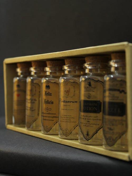 Clear Glass Bottles on White Wooden Shelf