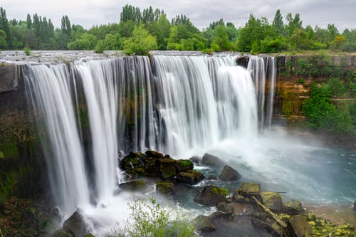 Waterfalls on Brown Rocks
