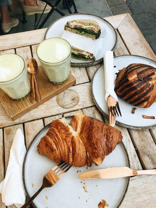 Bread on White Ceramic Plate Beside White Ceramic Mug