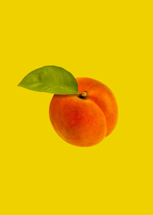 Orange Fruit With Green Leaves