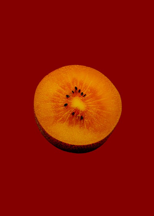 Yellow Round Fruit on Red Background