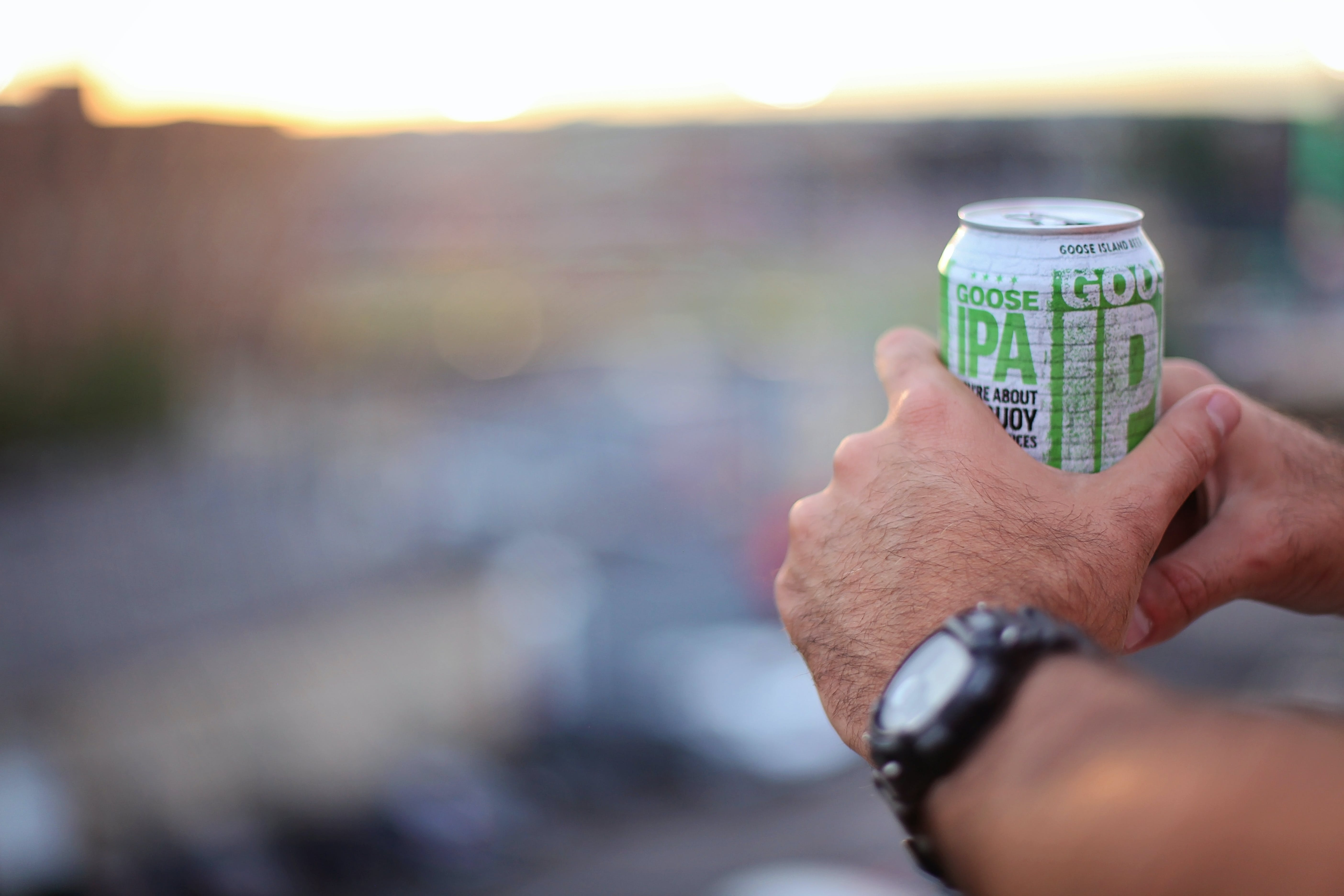 Selective Focus Photography of Person Holding Soda Can