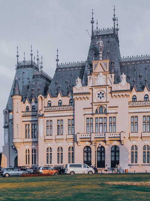 Facade of old historical palace against cloudy sky