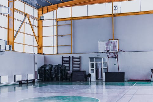 Indoor basketball court with hoops in sports club