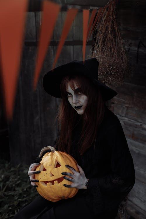 Witch Holding a Jack O Lantern