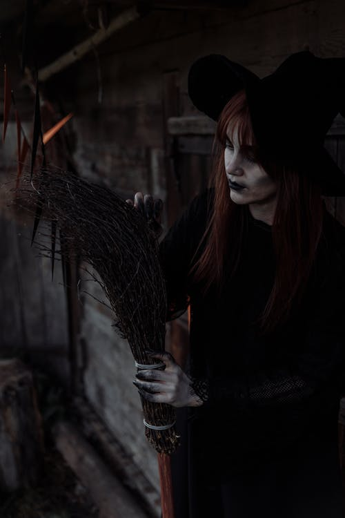 Witch Fixing her Broom