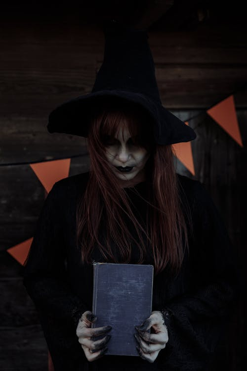 Witch Holder her Spell Book