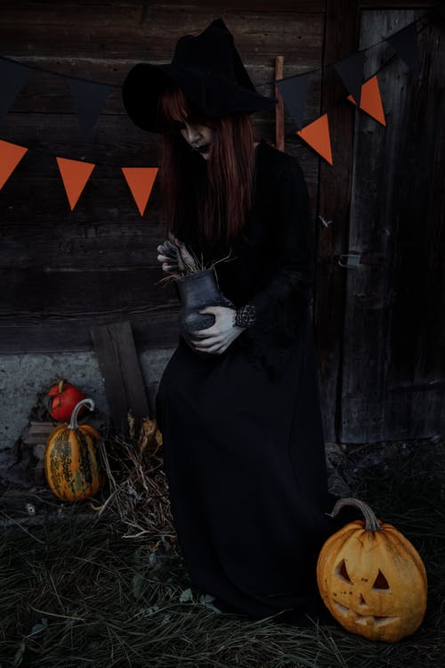 Witch Holding a Clay Jar