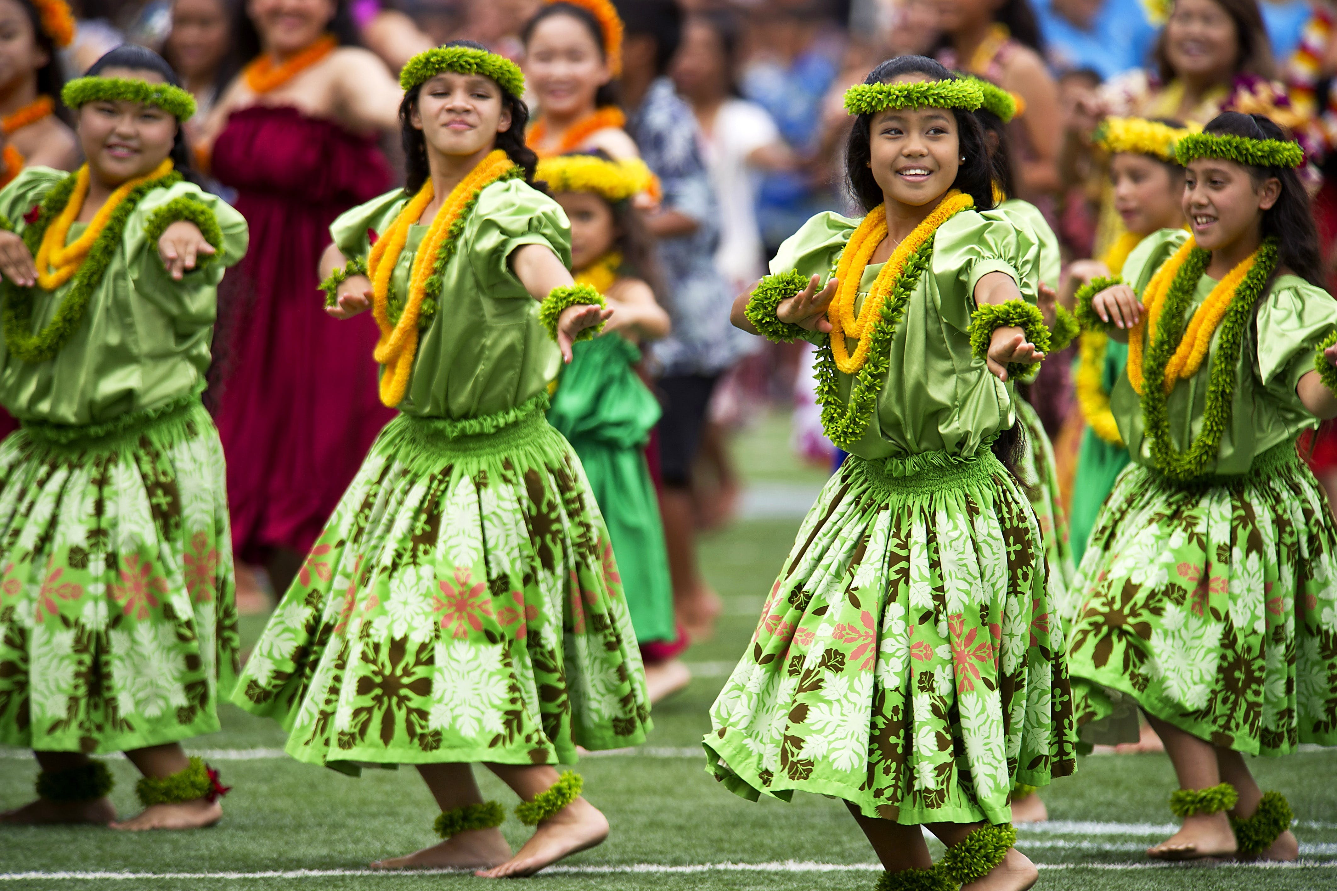 Girl's in Green Dress Dancing during Daytime With Leis