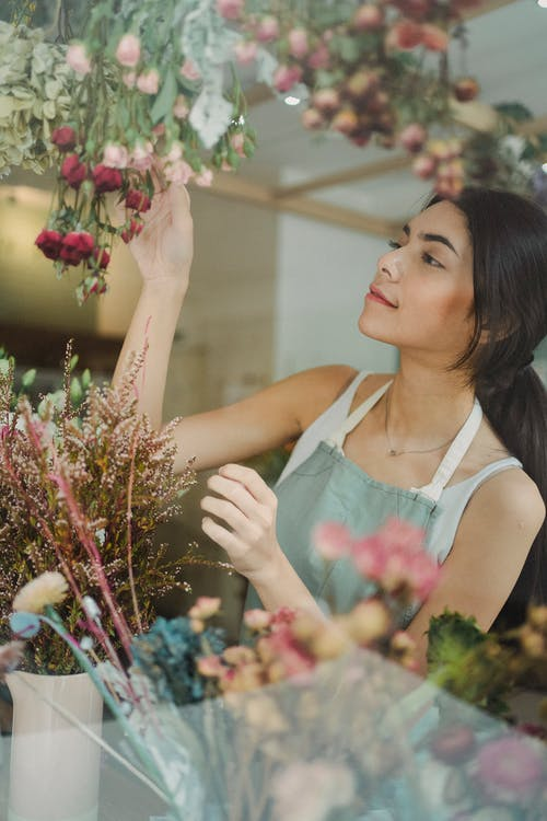 Charming woman forming bouquet of flowers