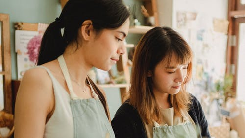 Focused multiracial women working in floral shop