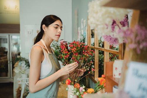 Thoughtful woman with bouquet of flowers