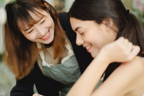 Happy multiracial women working together in shop