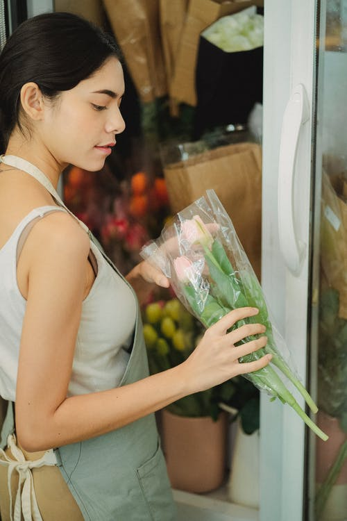 Woman with tulips in floral shop