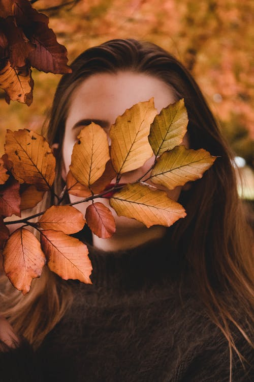 Brown Leaves on Womans Face