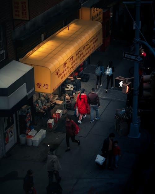 People Walking on Sidewalk of Market