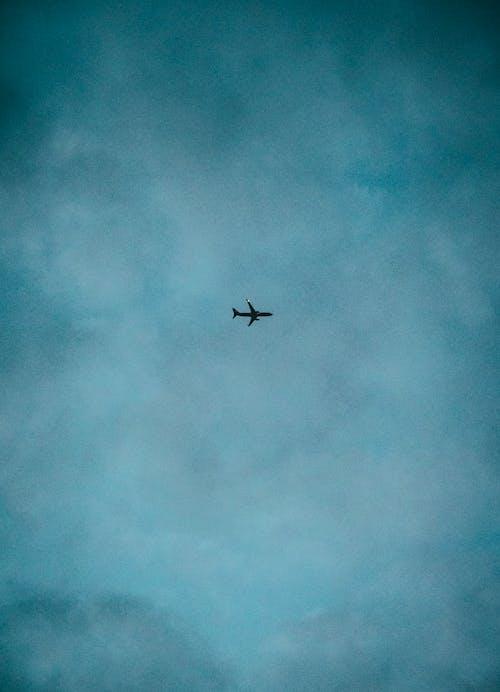 Airplane Flying Under Blue Sky
