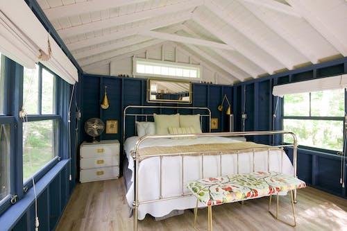White Bed Near White Wooden Drawer
