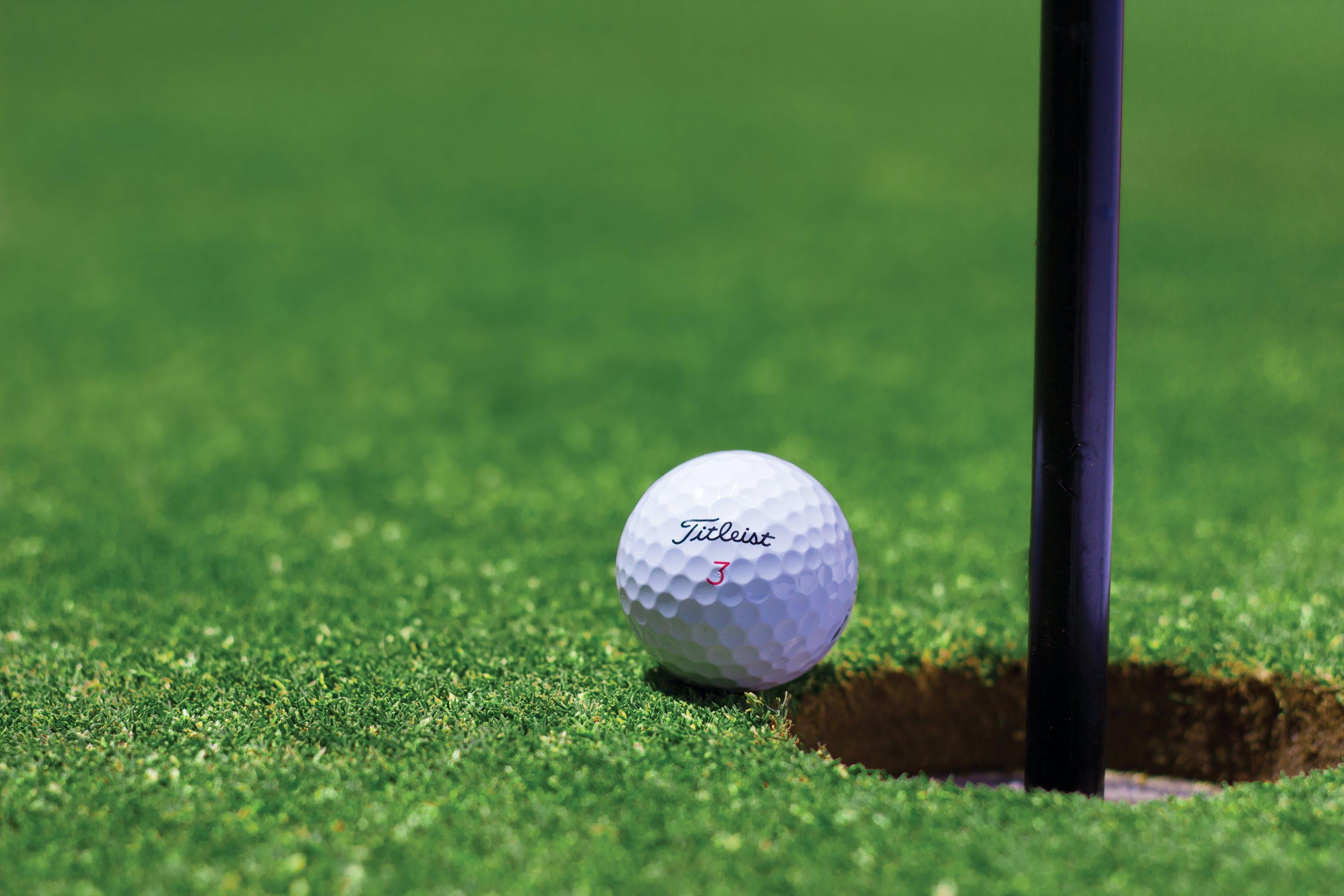Titrist Golf Ball Near Golf Hole