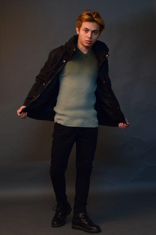 Trendy man with jacket in studio