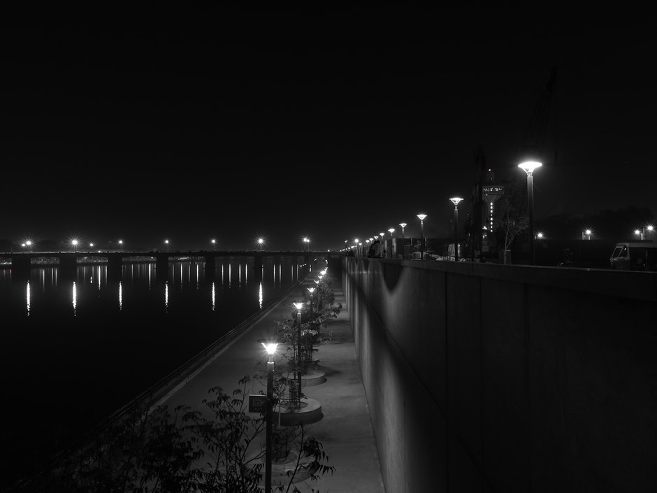 Lights Turned on during Nighttime in Grayscale Photography