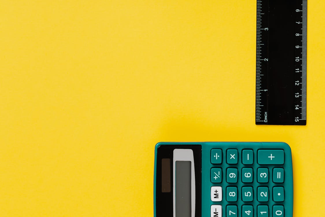 Black and Gray Calculator on Yellow Surface