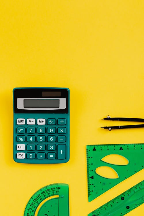 Green Calculator On Yellow Background