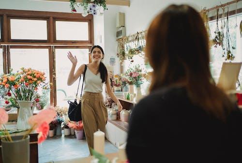 Happy woman waving to florist