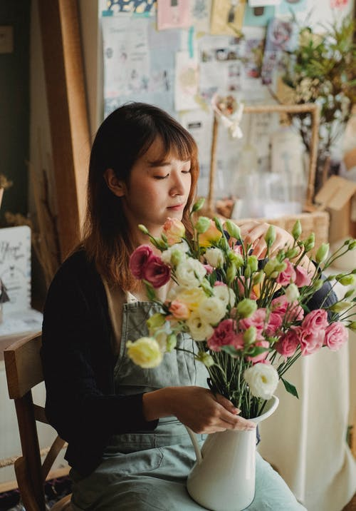 Female florist with bouquet of flowers