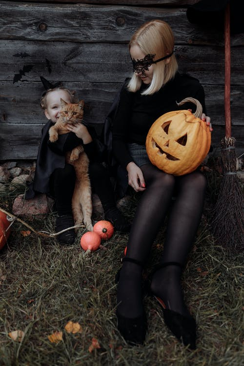Mom and Daughter in Halloween Costumes