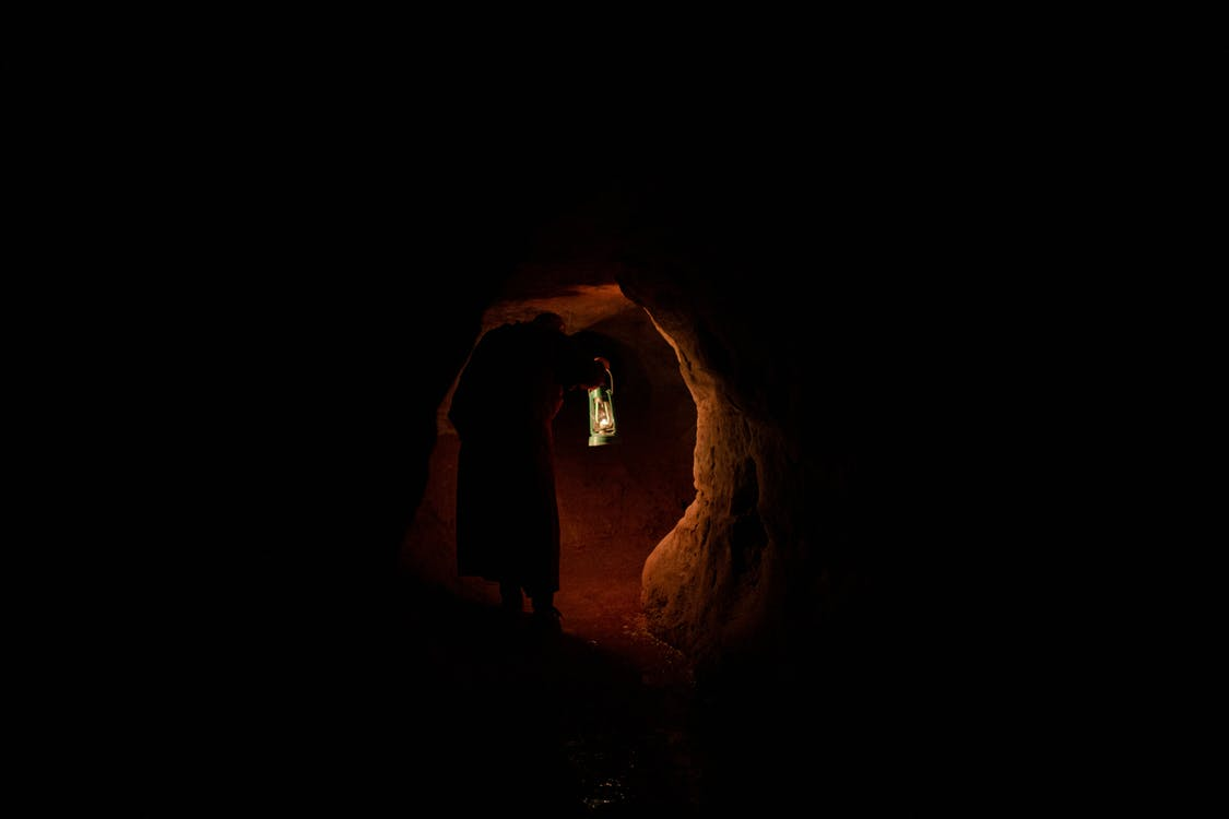 Silhouette of Person Inside Cave
