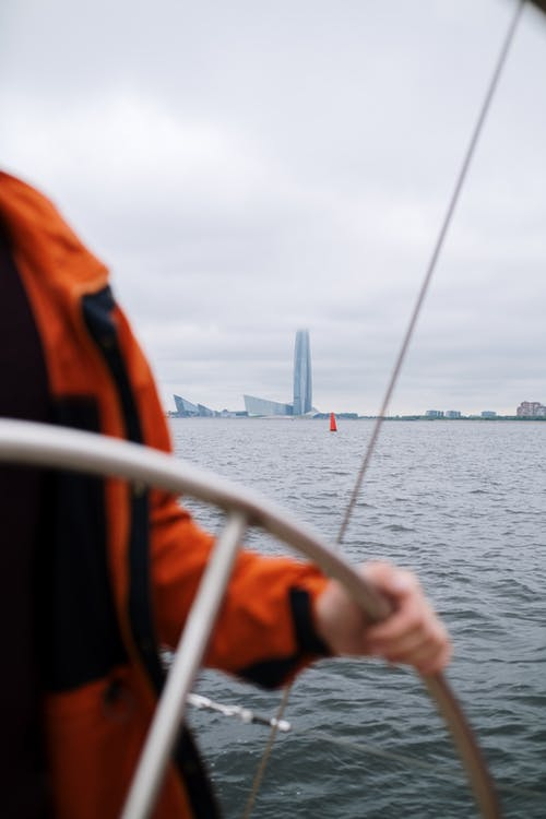 Person in Orange Life Vest on Boat