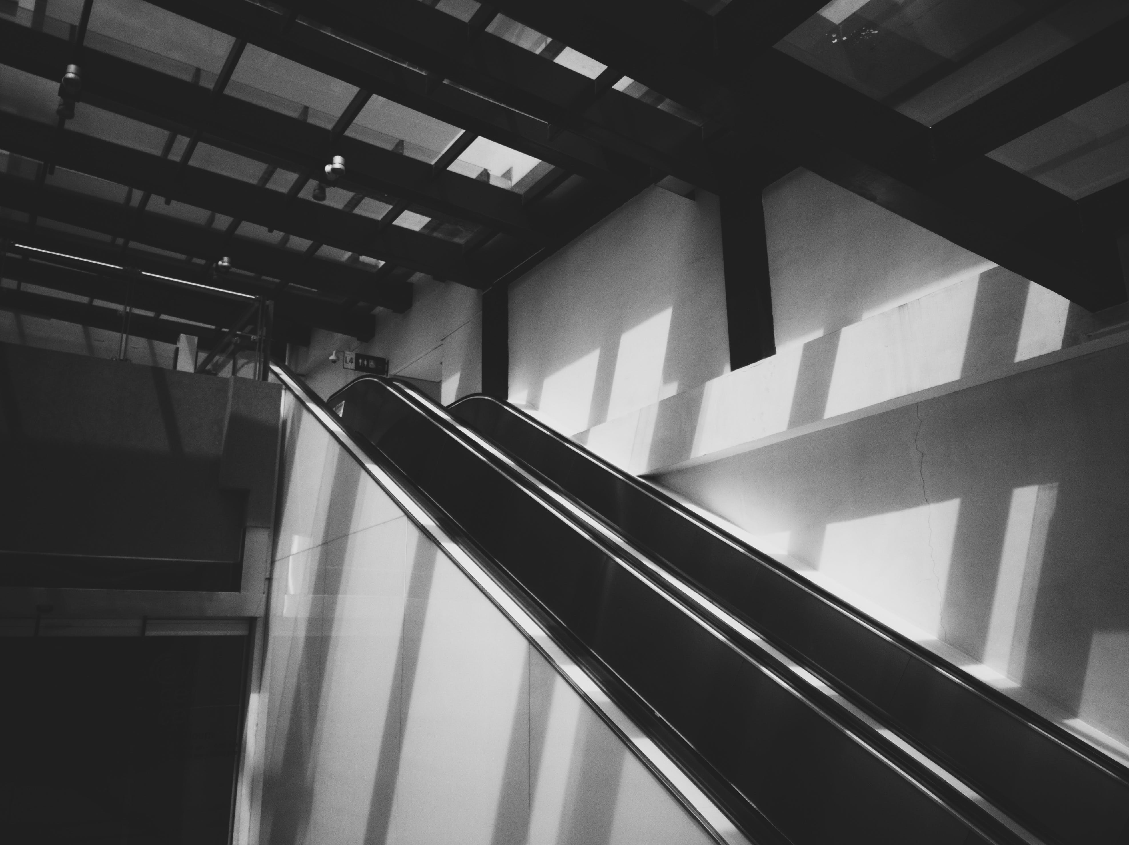 Free stock photo of architecture, black and white, escalator, mall