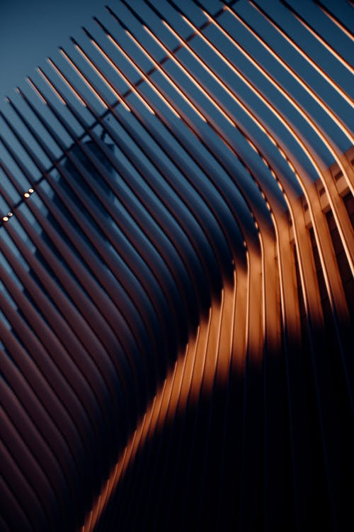 Textured background of contemporary geometric fence under blue sky