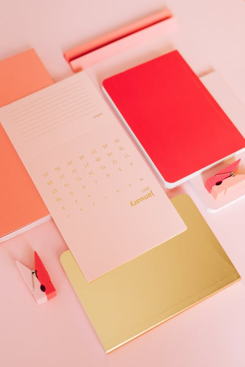 Composition of colorful notebooks and calendar
